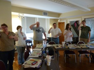 Participants act out a poem from the Kansas subsistence unit.