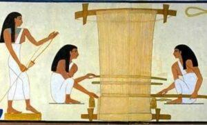 Image 4: Egyptians weaving using a vertical loom. Image from https://www.egypttoday.com/Article/4/89664/What-you-may-not-know-about-types-of-Linen-Fabrics